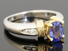 14ct White & Yellow Gold AAA Tanzanite Solitaire W/ Diamond Accent Ring (Size N)  https://www.jollysjewellers.com/product/14ct-white-yellow-gold-aaa-tanzanite-solitaire-w-diamond-accent-ring-size-n/