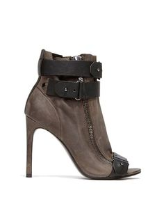 The HARBOR is a sexy peep-toe bootie with exposed zippers and modern snap belting details.