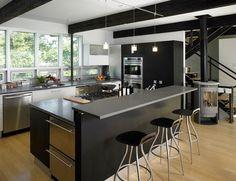 sleek black kitchen island with stools