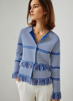 In Medium. Two-tone jacket made in thick, textured knit featuring a horizontal stripe and fringe design. It is collarless and fastens with two snap buttons.