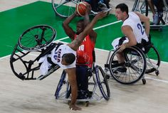 Rio Paralympics Basketball Gallery 5 - United States wheelchair basketball player Trevon Jenifer, left, goes horizontal in an attempt to block Great Britain's Abdi Jama, centre, during a preliminary game in Rio