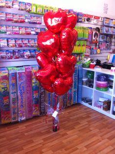 A dozen red heart balloon bouquet