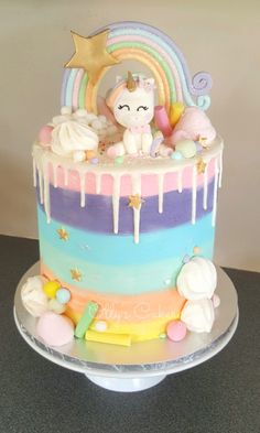Rainbow candyland unicorn cake. Buttercream with a white choc ganache drip. By Amber Hohepa of Ollys Cakery NZ