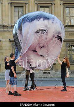 Munich, Germany. 05th June, 2015. Campaigning organisation 'ONE' balloon depicting German Chancellor #AngelaMerkel filled on the Odeonsplatz in Munich prior to #G7 countries meeting on 07 and 08 June 2015 in Schloss Elmau near Garmisch-Partenkirchen. Credit: dpa/Alamy Live News