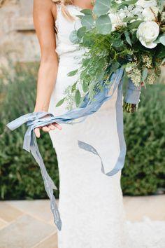 ช่อดอกไม้สีฟ้า ผูกริบบิ้นสีฟ้า   งานแต่งสีฟ้า   read more: sodazzling.com   Something blue wedding from Megan Welker Photography : meganwelker.com