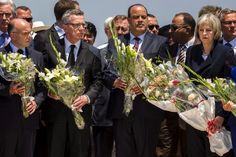 British Home Secretary Theresa May (front r.), French interior minister Bernard Cazeneuve (front l.), German Interior Minister Thomas de Maiziere (front 2nd l.) and Tunisia's Interior Minister Najem Gharsalli held bouquets of flowers as they paid their respects in front of a makeshift memorial at the beachside of the Imperial Marhaba resort, which was attacked by a gunman in Sousse, Tunisia on June 29, 2015.