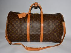 SOLD:  Authentic Louis Vuitton Monogram canvas Keepall 55 with the original shoulder strap, name tag and handle keeper.  Please see my site for authentic designer brand bags at lower price:  grantaboutique.com