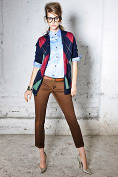 Like a boss: brown cafe pants, blue top, navy, fuchsia, mint argyle sweater with gold accents that go well with orange belt and gray pumps