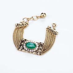 Gold Alloy Bracelet With Emerald Green Artificial Gemstones