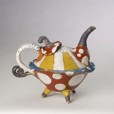"""Love this one.....This Flying Saucer Teapot by Dwo Wen Chen was wheel thrown and hand built. The glazes were applied by brush.  Dimensions: 6.0in H x 7.5in W x 9.5in L x 5.0in D  Dwo-Wen Chen describes his work as """"undisciplined and whimsical."""" Born and raised in Taiwan, educated at RISD, the artist has worked in his studio in Pawtucket, Rhode Island for the past 12 years and incorporates both traditional and modern influences into his clay work and glazing techniques."""