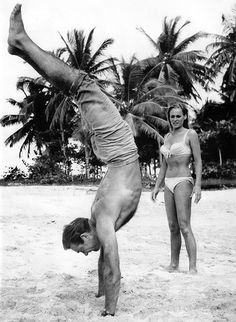 Sean Connery and Ursula Andress on the set of Dr. No [1962] Loved and pinned by www.downdogboutique.com to our community Pinterest boards.