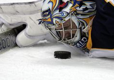 """""""Hello puck. I'm Ryan"""" Buffalo Sabres goalie Ryan Miller keeping his eye on the puck. Literally.<<<he's smiling at it XD"""
