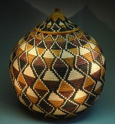 Africa | Very large Zulu Basket by May Zulu. May Zulu is a  master basket weaver from Kwa Zulu Natal. She is well known for tight woven, over sized beautiful baskets. Baskets can take up to two months to make. This basket measures + - 60 centimetres wide and is + - 65 centimetres tall.