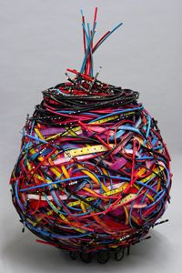 "Shannon Weber - 'Meet George Jetson"" mixed media basket, given to the Mulvane Museum at Washburn University, Kansas by the Mulvane Women's Board in memory of Lillian Dawkins. 