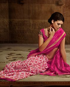 Pink and white printed sari   1. Pink and white bhagalpuri silk sari 2. White on pink printed design 3. Comes with matching unstitched blouse material