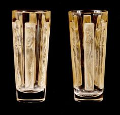 R LALIQUE, A PAIR OF SIX FIGURINE SEPIA STAINED SHOT GLASSES decorated with