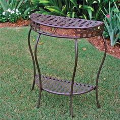 Santa Fe Nailhead Iron 2-Tier Half Moon Table Brookstone,http://www.amazon.com/dp/B004IVNQEO/ref=cm_sw_r_pi_dp_aSyVsb1Y8KHZK59H - meant for outdoors, could be cute as entry way table contract to wood furniture
