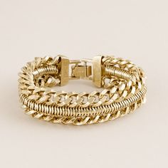 "A masculine-meets-feminine bracelet crafted of two curb chains soldered to a snake chain and finished with a shiny gold plating. Perfect to add a bit of toughness to a floaty blouse or a summery dress. Old English brass-plated brass chains. Foldover clasp closure. Import. Length: 7 3/4""."