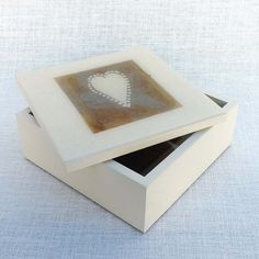 This wooden box will hold up to 6 coasters or anything else you choose to keep safe. A hand crafted recycled tea bag is preserved under resin on the lid.