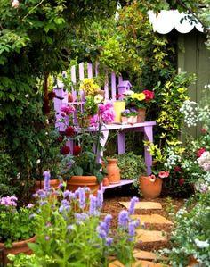 Purple garden bench flower pots