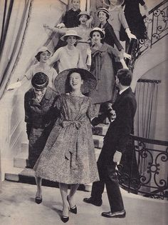 1958 Yves Saint Laurent welcomes his models for his first Dior collection