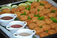 Panco crumbed fish cakes served with a Trio of dipping sauces