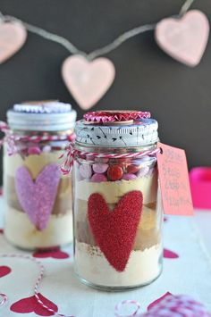 These little giftable Valentines' jars with grain-free chocolate heart cookie mix inside might be the cutest things ever. // via Nosh and Nourish