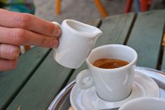 Morning black coffee with milk, outdors Black And White Black Coffee Close-up Coffee Coffee - Drink Coffee Break Coffee Cup Coffee Shop Coffee Time Coffeelover Coffeetime Cup Day Drink Food And Drink Human Hand Lifestyles Morning Coffee Outdoors People Street Food