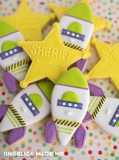 Toy Story inspired sugar cookies. Buzz Lightyear rockets and Woody sheriff stars.