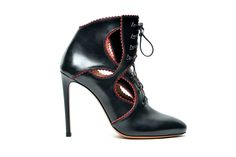 This standout cut-away ankle boot in black and oxblood leather was inspired by his dress designs from the Eighties.