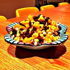 Mango, Corn, and Black Bean Salsa - Mix three large diced mangoes, one 15oz can of sweet corn (drained), and one 15oz can of black beans (drained and rinsed) in a large bowl; add 2 juiced limes and stir. Sprinkle ¼ cup chopped fresh cilantro over the mango mixture; toss to combine. Serve with chips or as filler for chicken fajitas!
