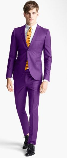 purple suit, orange tie...difficult to pull this off...possible...but difficult....the most important piece would be the attitude