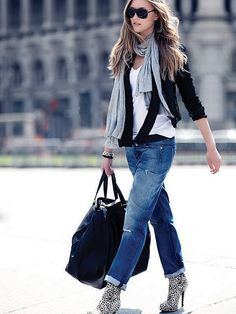 i like the layered top, simple jeans. not such a fan of the boots.