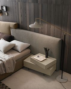 The I-night system_inclinART night stands can be fitted one on top of the other. They are shown on the right in matt beige seta lacquer with methacrylate feet. By Presotto