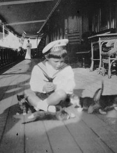 Alexei with kittens on the Standart about 1910.