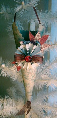 Georgia's Christmas Ornaments @Greetings...From Kimberly Shaw: Isn't this Christmas Ornament dreamy? Georgia will be bringing her hand made one of a kind ornaments to my Open House this Saturday Nov 28th. These pretty paper cones are perfect for adding a special treat inside to give as a gift. She will be covering her feather tree with a wonderful selection in different colors and designs. (No instructions for making this or purchase is given...it is from Nov. 25, 2009)