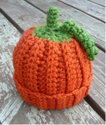 "FREE CROCHET Pumpkin hat pattern for a newborn  Use a smaller hook to make it for a 18"" American Girl Doll.  Dress your little one up this Halloween by crocheting a pumpkin beanie. This is for the newborn zero to three months old. By  Danyel Pink, let's see if I can make it bigger!"