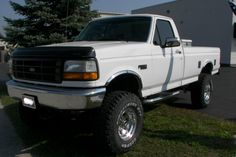white lifted Ford Truck