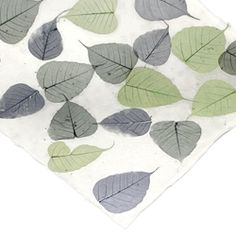Incorporate the beauty of the tropics to your crafts with the Boda Leaf Heavyweight Mulberry Paper! Handmade in Thailand, this Kozo paper features blue and green skeleton leaf inclusions on a natural white base. This heavyweight paper weighs 200 gsm with a thick, textured surface consisting of mulberry and Kozo pulp. The acid-free Boda Leaf Mulberry Paper is perfect for note cards, book binding, weddings, invitations, and more!