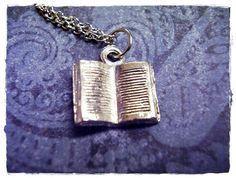 Hey, I found this really awesome Etsy listing at https://www.etsy.com/listing/83518409/silver-open-book-necklace-silver-pewter