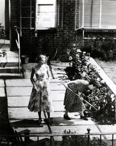 "grace kelly and thelma ritter digging up evidence in ""rear window"" (1954, dir. alfred hitchcock)"