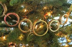 Mason Jar Lids Garland---I could see this working for a rustic/country Christmas theme.