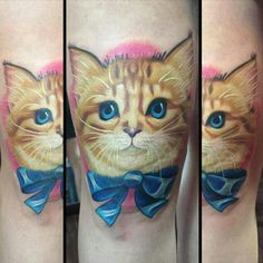 Kitten with a bow tattoo