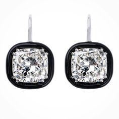 Nikos Koulis Jewels. The original black enamel frame to 10cts D IF white diamonds.