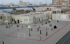 A football field at the Sharjah Museum Square in which street furniture interferes with the game. Different ways of experiencing the public space coexist in this football field; it suggests new uses for the square and a new structure for the urban space. / Maider Lopez