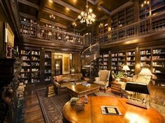 Embrace inner bookworm in this WI chateau's impressive two-story library, complete w/ spiral staircase & dark wood finishes