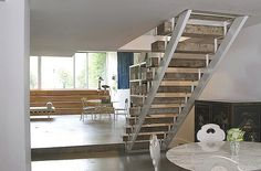 open staircase, poured concrete floors.  elizabeth roberts, architect.  photo by sean slattery.
