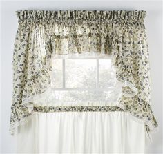 Clarice Colored Leaf Print Ruffled Swags Window Curtains offer an attractive colored leafy print against a natural color background and are adorned with a delicate lace edging. Print features green leaf with choice of red, blue or violet color patterns.