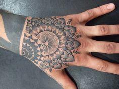 Mandala hand tattoo.    Tattoo artist unknown.