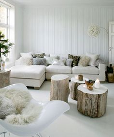 Traditional scandinavian living room interior. Love the tree stump tables.